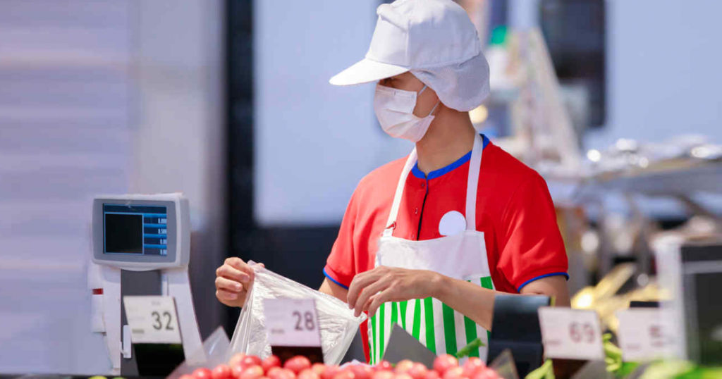 Cashier with Face Mask